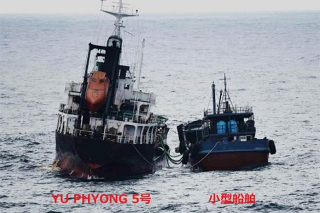 Tokyo issued this photo of a North Korean ship (L) refueling at sea with the assistance of another vessel. Photo courtesy of Ministry of Foreign Affairs of Japan