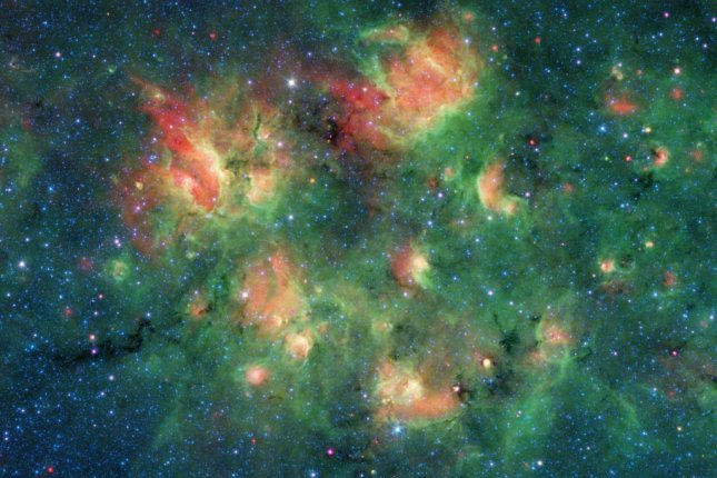 With the help of citizen scientists, astronomers at NASA are mapping bubbles and bow shocks produced by new stars in dense Milky Way nebulae. Photo by NASA/JPL-Caltech