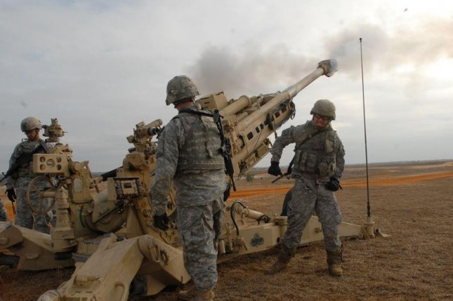 Troops at Fort Bragg, N.C., engage in howitzer practice. The base is one of 10 named after Confederate military leaders. A House version of the defense budget allots $1 million for name changes. Photo by S1C Jacob McDonald/U.S. Army