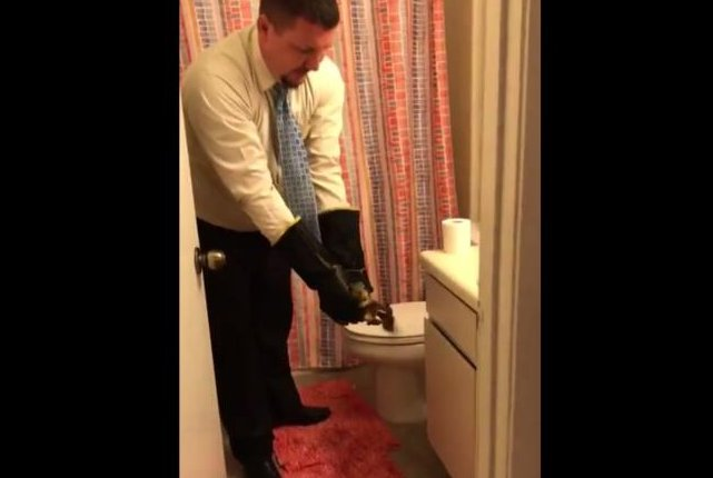 A Texas man removes a squirrel from a friend's toilet. Screenshot: Newsflare