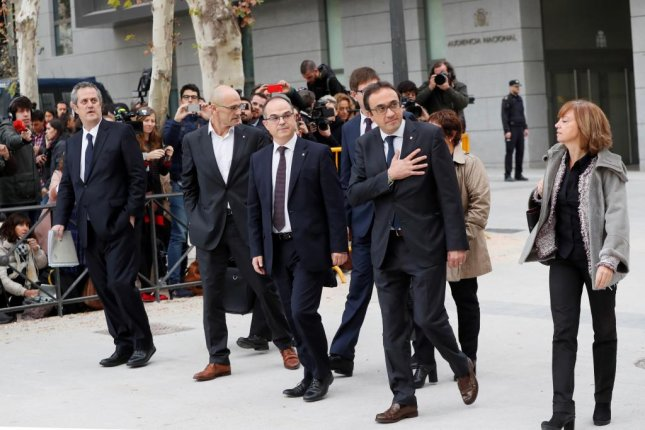 Former Catalan officials arrive to testify Thursday in response to a court order, which mandated they explain their actions in Catalonia's failed bid for independence. Photo by Fernando Alvarado/EPA