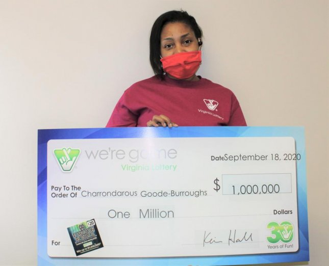 Charrondarous Goode-Burroughs of Richmond, Va., won $1 million from a lottery ticket her son gave her as an anniversary present. Photo courtesy of the Virginia Lottery