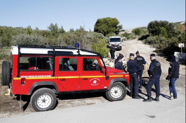 French police establish a security perimeter Monday near the site of a helicopter crash in Le Rove, about 10 miles away from Marseilles in southern France. Photo by Guillaume Horcajuelo/EPA-EFE