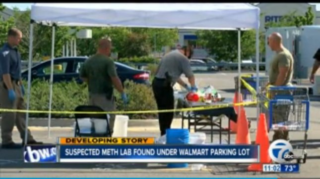 Police investigate materials recovered from the suspected meth lab under an Amherst, N.Y., Walmart's parking lot. Screenshot: WKBW-TV
