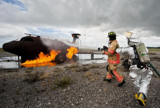 Air Force firefighters put out a fire at Eglin Air Force Base in Florida. The firefighting foam used by military personnel has been known to contain cancer-causing chemicals, which have leaked into local water supplies around the country. File Photo by Samuel King Jr./U.S. Air Force