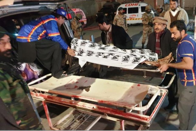 Hospital workers move the bodies of those who died in an explosion in a Quetta, Pakistan, mosuw on Friday. At least 14 people were killed. Photo by Jamal Tasgai/EPA-EFE/UPI