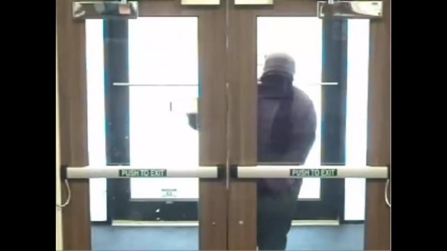 A bank robber at the Security National Bank in Omaha Wednesday morning struggled for several seconds to push his way into a pull door. OmahaCrimeStoppers/YouTube video screenshot