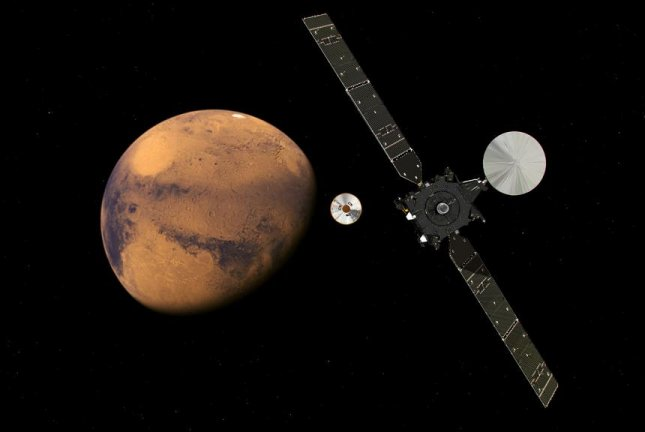 An artistic rendering shows the Trace Gas Orbiter and Schiaparelli lander approaching Mars. Photo by ESA/ATG medialab