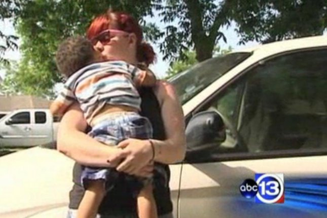 Dorothy Baker-Flugence fought off an armed carjacker, then ran him over, all with her two young children in the car. (Screenshot via KTRK-TV)