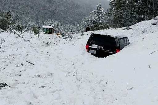 A series of avalanche buried three cars and caused temporary closures of two Colorado roadways on Thursday. Photo courtesy Colorado Springs Police Department District 4/Twitter