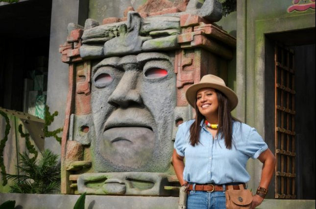Cristela Alonzo talks to Olmec in Legends of the Hidden Temple. Photo courtesy of The CW