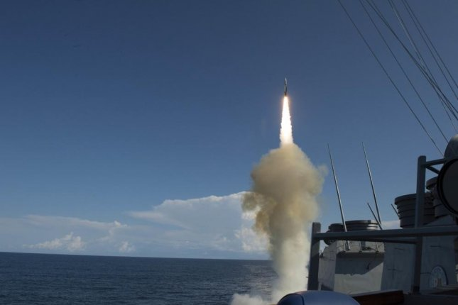 The USS Arleigh Burke successfully launches an SM-2 Standard Missile from the aft Vertical Launching System. The launch was part of tests of the AEGIS system with the Spanish navy ship Cristobol Colon. Photo by Mass Communication Specialist Seaman Maria I. Alvarez/U.S. Navy