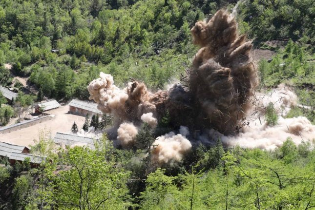 Earth is displaced during an explosion on the first day of dismantling at North Korea's Punggye-ri nuclear test site in Punggye-ri, North Korea, on May 24, 2018. Photo by News 1/EPA-EFE