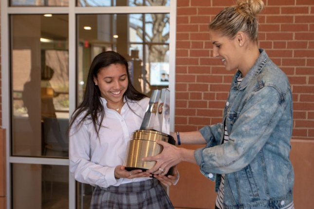 a9ff7ca9647d Sophomore Azzi Fudd receives the 2019 Gatorade National Girls Basketball  Player of the Year award from WNBA star Elena Delle Donne on Tuesday at St.  John s ...