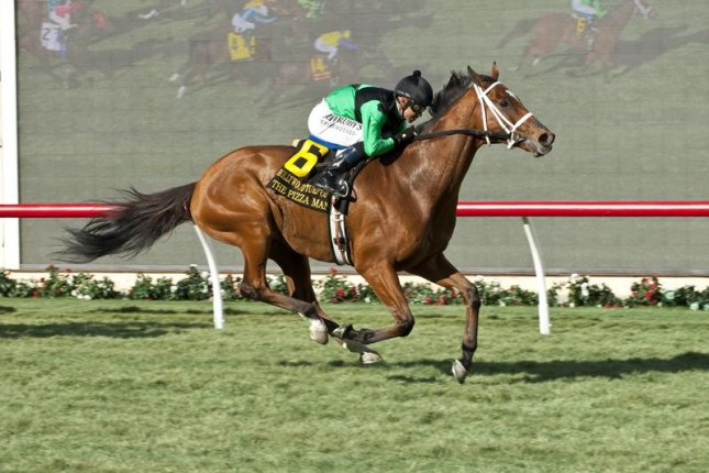 The Pizza Man missed the Japan Cup but happily won Thursday's Hollywood Turf Cup at Del Mar. Benoit photo/Del Mar