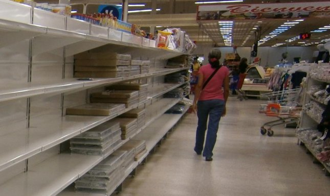 Empty shelves in a Central Madeirense supermarket, the largest grocery chain in Venezuela in 2014. Though food and medicine shortages persist nationwide, a new measure passed by the National Assembly will provide cash and other assistance to seniors and retirees struggling with Venezuela's staggering inflation. Photo courtesy Wikimedia