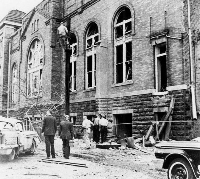 Police investigators inspect bombing damage on the eastern facade of 16th Street Baptist Church in Birmingham, Ala. on September 15, 1963. Photo courtesy Birmingham Public Library