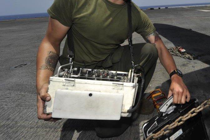 An Identification Friend or Foe test set is moved on the flight deck of the USS Bataan. Photo by Michael Lieberknecht