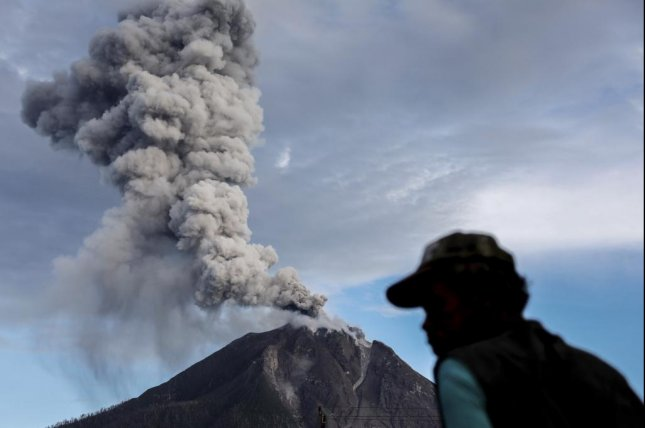 Mount Sinabung erupts near Tiga Pancur, in Karo, North Sumatra, Indonesia, on November 16, 2017. The volcano began erupting again Tuesday. File Photo by Dedi Sinuhaji/EPA-EFE