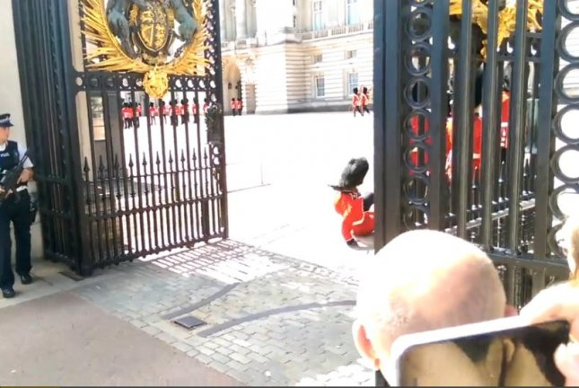 A Queen's Guard falls onto his rump during the changing of the guard at Buckingham Palace. Newsflare video screenshot