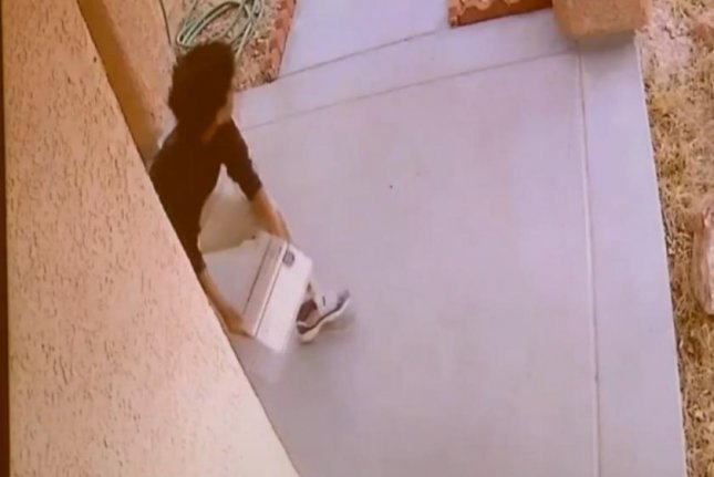 A young man steals a package filled with dog poop from Eric Burdo's Las Vegas porch. KTNV-TV video screenshot