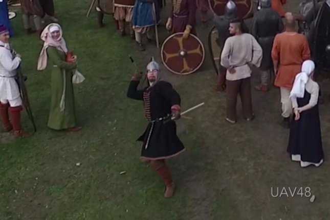 A medieval reenactor throws a spear at a drone. Screenshot: Gennady Tolcheev/YouTube