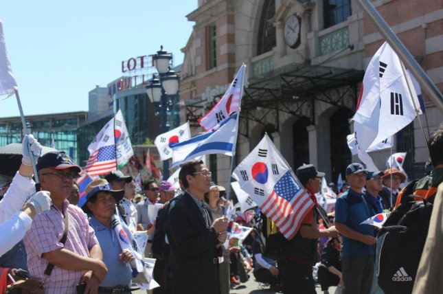 Conservative South Korea protesters gathered at Seoul Station on Saturday say they are not happy with the imprisonment of former President Park Geun-hye. Photo by Elizabeth Shim/UPI