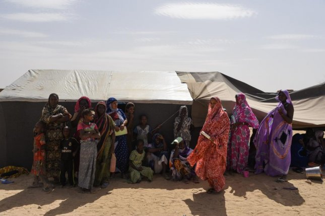 Displaced Malian citizens are seen in the village of Koygouma, Mali, on May 6 as a United Nations delegation visits. Photo byNicolas Remene/EPA-EFE