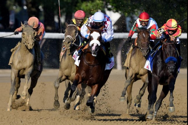 Tiz the Law (C) heads for victory in the Grade I Travers at Saratoga, confirming his favorite status for the Kentucky Derby. Photo by Elsa Lorieul, courtesy of New York Racing Association