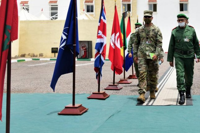 U.S. Army Maj. Gen. Andrew Rohling and Moroccan Army General d-armee Belkhir El Farouk enter the Rehearsal of Concept Drill on Monday for African Lion in Agadir, Morocco. Photo courtesy of U.S. Africa Command Public Affairs