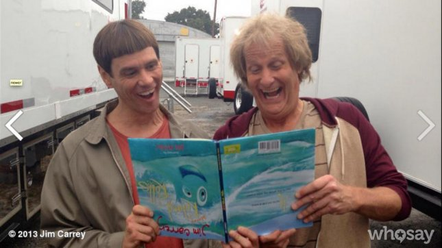 Harry and Lloyd try to read How Roland Rolls. (Whosay/Jim Carrey)