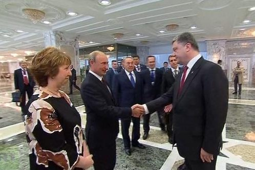Russian President Vladimir Putin (c) shakes hands with Ukrainian President Petro Poroshenko (r) while European Union foreign policy chief Catherine Ashton looks on. The leaders gathered in Minsk, Belarus on August 26, 2014 for direct negotiations regarding the conflict in eastern Ukraine. (Twitter/European Union)