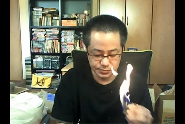 A Japanese game streamer accidentally sets fire to his lighter before the flames spread to the rest of his apartment. Mitt/YouTube video screenshot