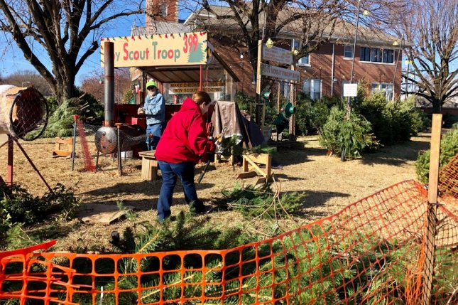 The wholesale cost of Christmas trees sold at this Boy Scout lot in Evansville, Ind., rose 25 percent this year, according to troop leaders. The price spike is a result of smaller supplies. Photo by Jessie Higgins/UPI