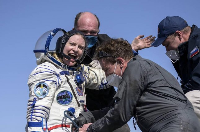 NASA astronaut Kate Rubins is helped out of the Soyuz MS-17 spacecraft minutes after she and Russian cosmonauts Sergey Kud-Sverchkov and Sergey Ryzhikhov landed Saturday. Photo by Bill Ingalls/NASA
