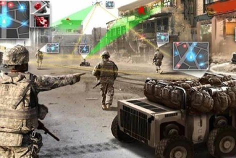 Combined-arms squads allow soldiers and Marines to fight off electromagnetic and cyber threats at the same time they fight physical ones, Pentagon officials say. Photo courtesy of DARPA