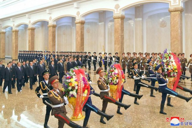 North Korea senior officials attend a ceremony at the Kumsusan Palace of the Sun in Pyongyang on Wednesday, according to North Korea state media. Photo by KCNA/EPA-EFE