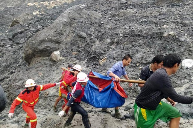 Rescue workers carry a victim after a landslide Thursday at a jade mining site in Hpakant, Kachin State, Myanmar. Photo by Myanmar Fire Services Dept./EPA-EFE