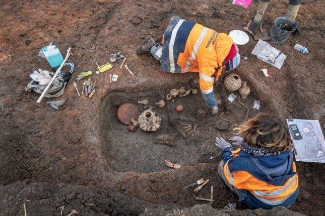 French archeologists dig at an ancient child burial site recent at the Clermont-Ferrand Airport. France's National Institute of Preventive Archaeological Research said Thursday the site dates back 2,000 years. Photo courtesy of National Institute of Preventive Archaeological Research Twitter