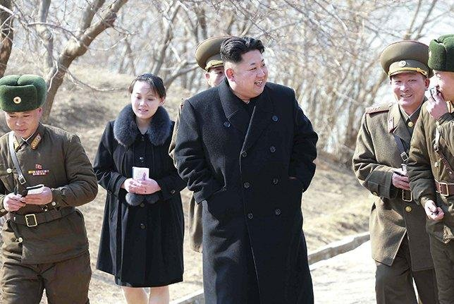 Kim Jong Un's sister Kim Yo Jong, rear left, is married to a man of ordinary background, according a source on North Korea. File Photo by Rodong Sinmun