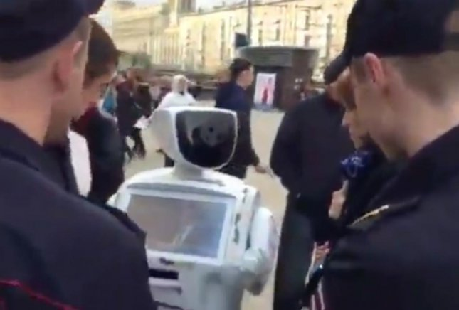 Russian robot Promobot was detained by police while conducting a survey at a political rally in Moscow. promobot had previously escaped from its lab and caused a traffic jam in June.  Screen capture/Promobot/Facebook