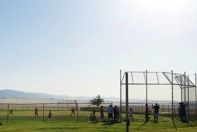 Children play at a ballfield at Reef-Sunset Middle School in Avenal, California. The school has had problems with water contamination from disinfectant byproducts and another school in the district has high levels of arsenic. Photo by Tara Lohan/Water Deeply