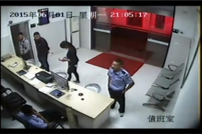 This man posed as a police officer at the Yongxing station June 1 in an attempt to secure the release of a friend who turned out not to have been arrested. Newsflare video screenshot