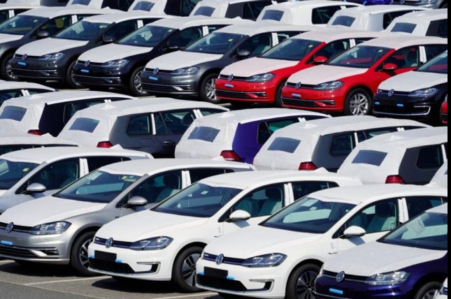 New Volkswagens are lined up at a Schonfeld, Germany, airport. A trial involving a $10 billion claim by investors against Volkswagen, the first court case in its diesel emissions scandal, opened on Monday in Braunschweig, Germany. Photo by Alexander Becher/EPA-EFE