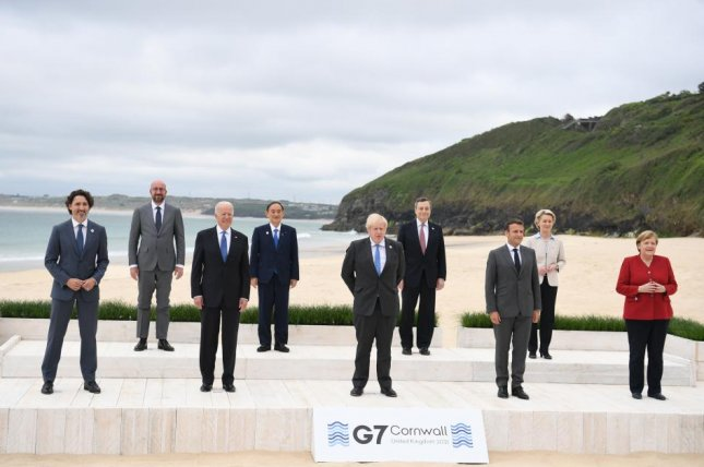 Leaders attending the G7 summit, Justin Trudeau (L to R), Canada's prime minister; Charles Michel, president of the European Council; U,S. President Joe Biden, Yoshihide Suga, Japan's prime minister; Boris Johnson, Britain's prime minister; Mario Draghi, Italy's prime minister; Emmanuel Macron, France's president; Ursula von der Leyen, president of the European Commission, and Angela Merkel, Germany's chancellor pose during on the first day on the beach i Carbis Bay, Cornwall, Britain. Photo by Neil Hall/EPA-EFE/International Pool