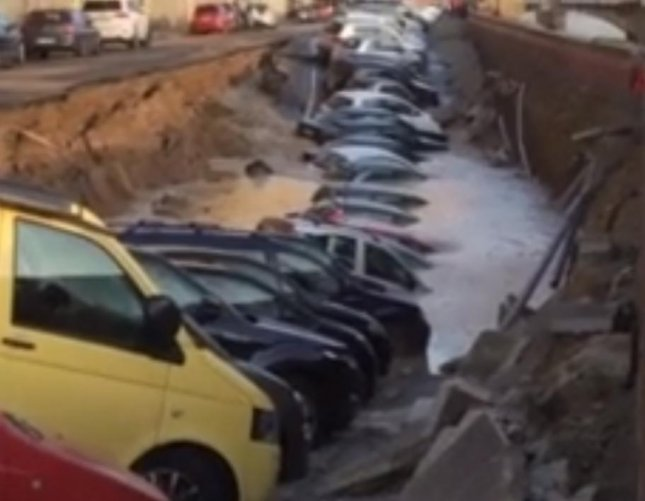 About 20 cars fell into a sinkhole that opened up on an Italian street on Wednesday morning. Authorities believe the more than 600-foot long sinkhole was caused by a broken aqueduct pipe that released water, eroding part of the street. The area was closed off to prevent further damage but no one was injured.