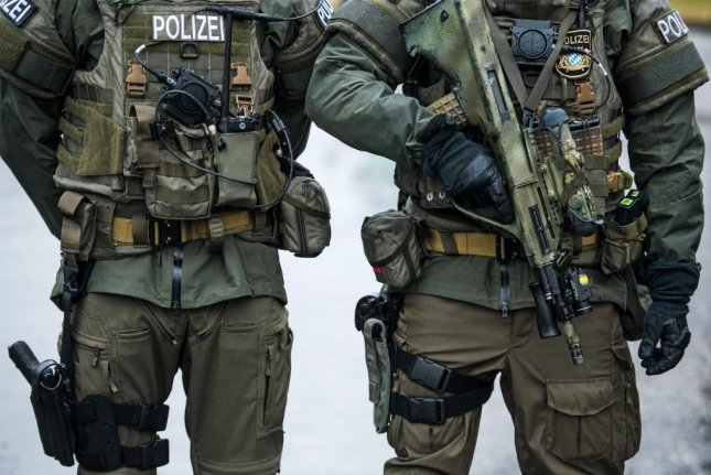 Officers of the German special police force SEK take part in the GETEX anti-terror-exercise in Murnau, Germany last month. A German army lieutenant was arrested after posing as a Syrian refugee in order to carry out a terrorist attack, police said. Photo by Christian Bruna/EPA