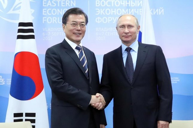 The administration of South Korea's Moon Jae-in (L) may be moving to encourage the full participation of Russian athletes after suffering several setbacks. File Photo by Yonhap