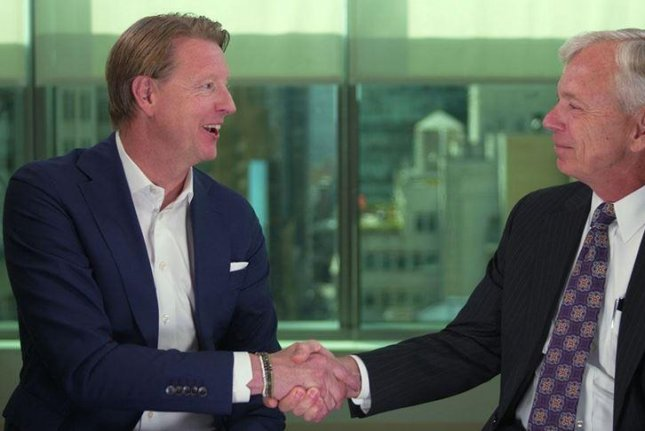 Hans Vestberg (L) will become Verizon CEO on August 1, the company said Friday. He will replace Lowell McAdam, at right. Photo courtesy Verizon Communications