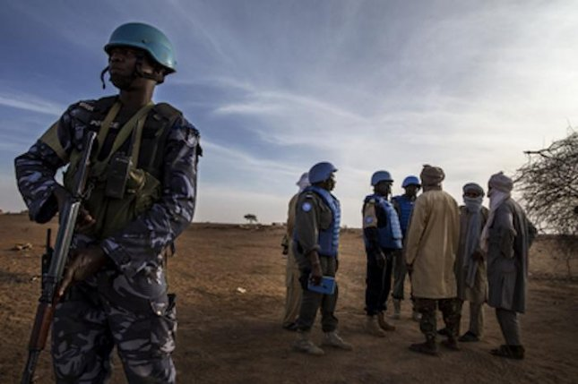 Peacekeepers from the United Nations Multidimensional Integrated Stabilization Mission in Mali patrol Menaka. Two MINUSMA peacekeepers were killed during attacks in northern and central Mali on Saturday. Photo by Marco Dormino/United Nations